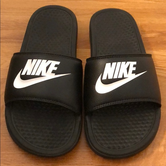 5839f0375 Nike men s slides super comfy great condition. M 5b8d6d1f9264afadac0dc0db.  Other Shoes you may like. Nike women s 7.5 purple